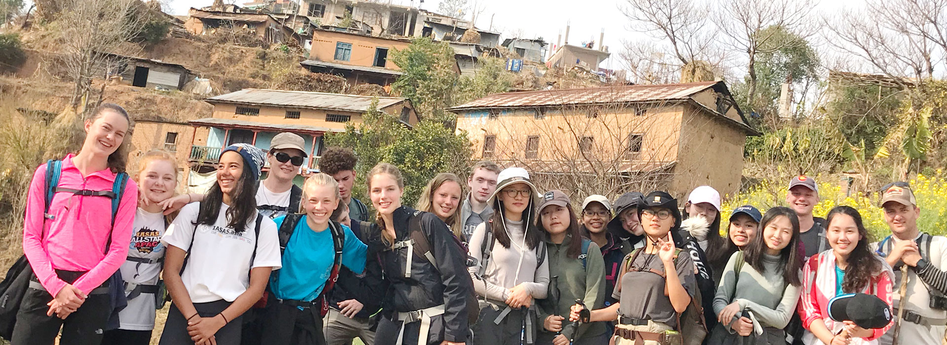 International Students Trekking Through A Typical Nepalese Village.Moonlight Nepal